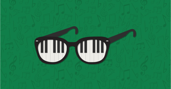 Cartoon of spectacles with piano keys as lenses against green background